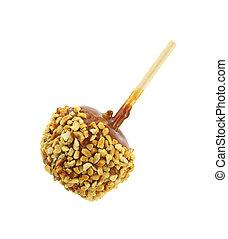 Caramel coated apple - A caramel coated apple with stick on...