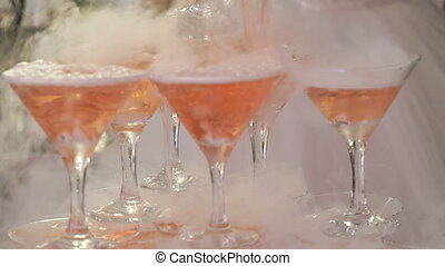 Goblets with seething rose wine - Feast alcohol. Close-up of...