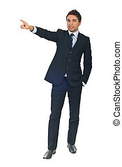 Business man pointing to copy space - Full length of young...