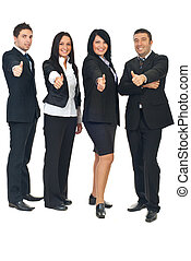 Group of business people gives thumbs - Full length of four...