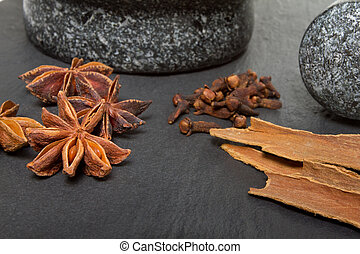 Spice mix - Granite mortar and pestle with winter spices of...