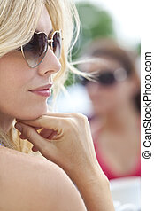 Side Profile of Blond Woman in Heart Shaped Sunglasses