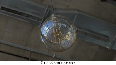 Glass orb lamp hanging in the ceiling - Low angle shot of...