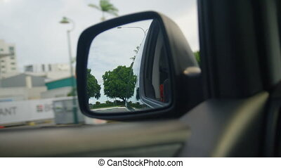 A close up shot of the car's side mirror - A shot of a car's...