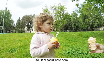 Child with soap bubbles - Girl child blows soap bubbles from...