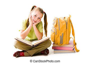Diligent girl - Portrait of cute schoolgirl with open book...