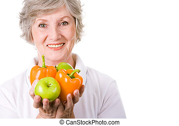 Healthy woman - Portrait of aged female holding apples and...