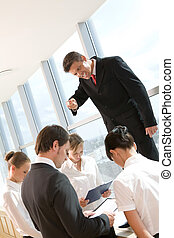 Angry boss - Angry ceo shouting at his employees surrounding...