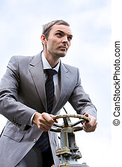 Steering boss - Portrait of strong leader steering on...