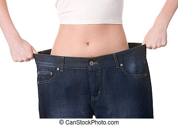Weight loss - Close-up of female figure with jeans of...