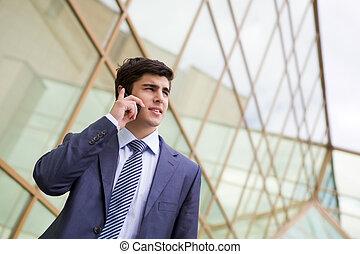 Telephone conversation - Portrait of confident businessman...