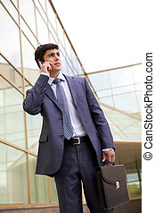 Calling businessman - Portrait of confident businessman...