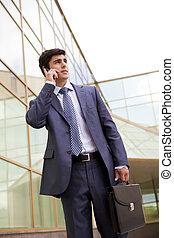 Calling businessman - Portrait of confident businessman...