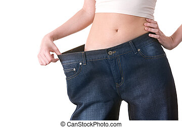 Successful diet - Close-up of female figure with jeans of...