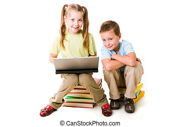 Teamwork - Smart girl with laptop and cute boy near by...