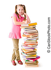 Schoolchild - Portrait of cute schoolgirl standing by stack...