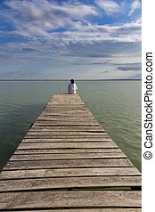 Young girl out on the wooden pier