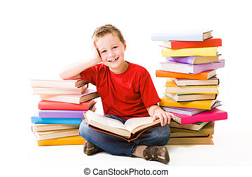 Reading boy - Image of schoolboy sitting between two heaps...