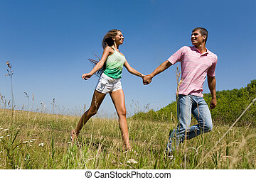 Walk outside - Photo of young man and woman taking walk in...