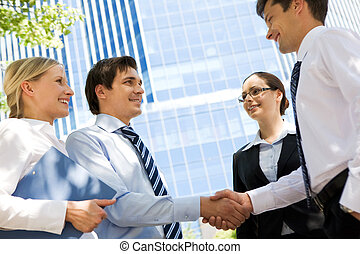 Business deal - Photo of successful partners handshaking...