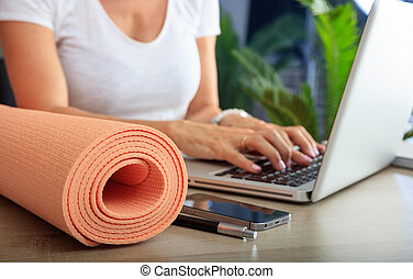 Woman and an exercise mat in an office background - Relax at...