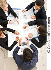 Planning - Above view of friendly workteam discussing new...