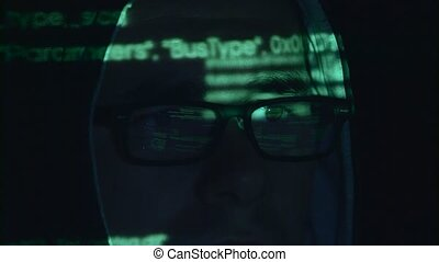 Man is hacking the cyberpolicy web site. Close up - Man sits...