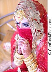 Young arabic bride Praying at wedding receptions. - Young...