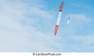 RC soaring plane on blue sky - RC remotely controlled...