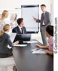 Presentation - Image of confident businessman doing a...