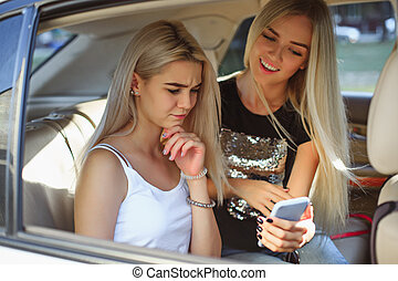 The pretty european girls 25-30 years old in the car make...