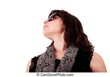 portrait of a young woman looking up with sunglasses, isolated on white background. Studio shot