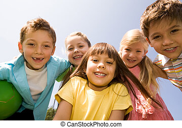 Happy children - Portrait of happy children embracing each...