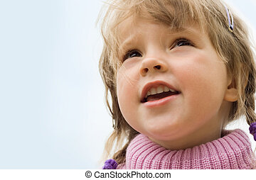 Pretty child - Portrait of cute girl looking forward outside