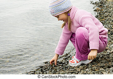 Enjoying water - Pretty girl in violet clothes touching...
