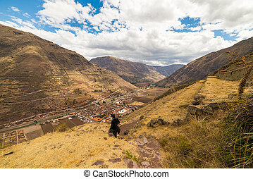 Tourist exploring the Inca Trails and the majestic terraces...