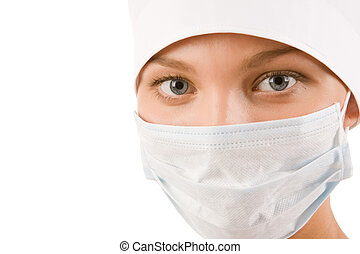 Blue collar worker - Face of nurse in sterile mask looking...