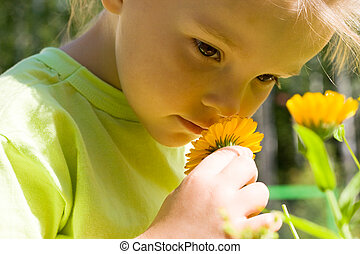 Smelling flowers - Close-up of innocent girl enjoying nice...