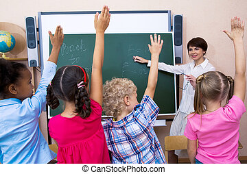 Who knows - Image of pupils stretching their hands during...