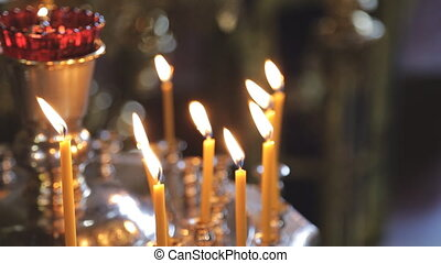 close up Many candles burn in church for fulfillment of...