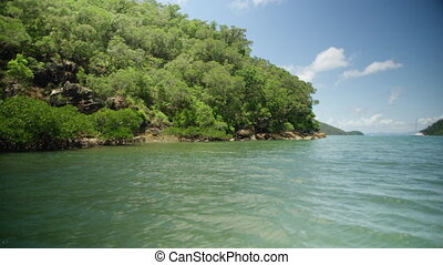 Sailing through an uninhabited island - A shot from a boat...