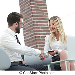 handshake business people in the office. the concept of...