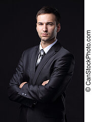 portrait of a handsome businessman .isolated on a black...