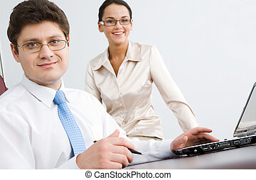Confident boss - Photo of smiling confident boss looking at...