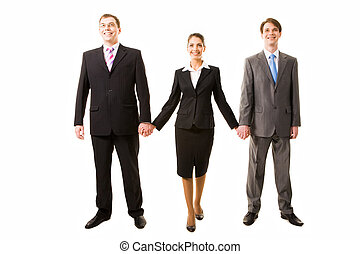 Business team - Team of three business people holding each...
