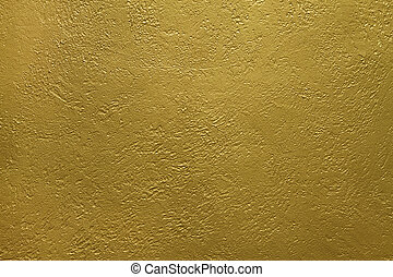 wall texture - texture of a cement wall covered with gold...