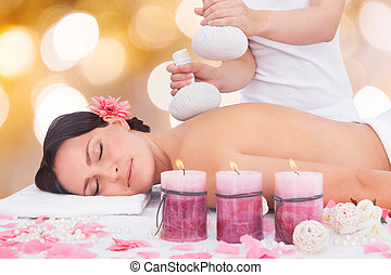 Woman Getting Herbal Compress Ball Therapy - Beautiful Young...