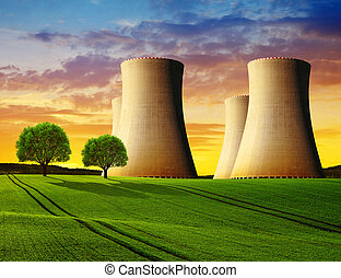 Cooling towers of a nuclear power plant in the sunset.