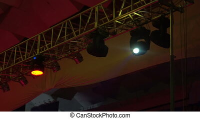 strobe lights emitting different color beams hanging under the ceiling