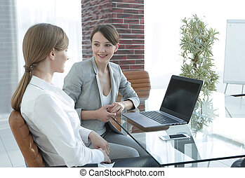 business team discussing business issues in office. the...